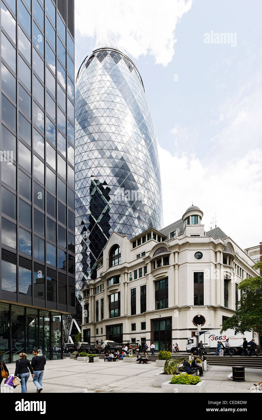 Mixed architecture twilight modern and classical architecture swiss re tower the gherkin tower london