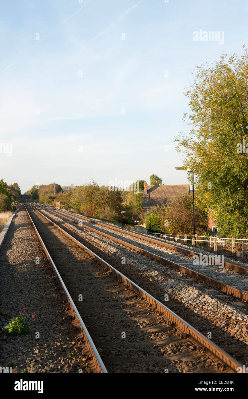 Railway lines stretching into the distance, Wootton Wawen train station, Warwickshire, England, UK - Stock Image