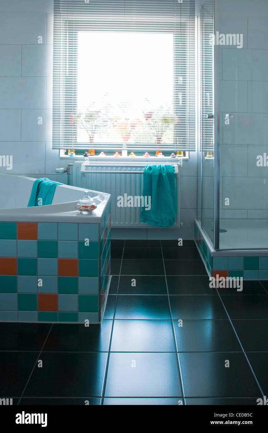 White bathroom, black floor, colorful decorated with tiles in light ...