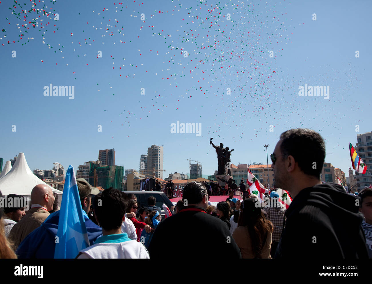 Balloons fly over Martyrs Square, Beirut, Lebanon, at a political rally which up to a million people attend. - Stock Image