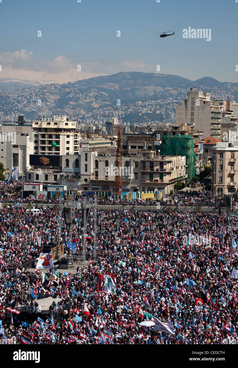 Up to a million people fill Martyrs Square in Beirut, Lebanon. Snow-capped mountains seen beyond city-centre towers Stock Photo