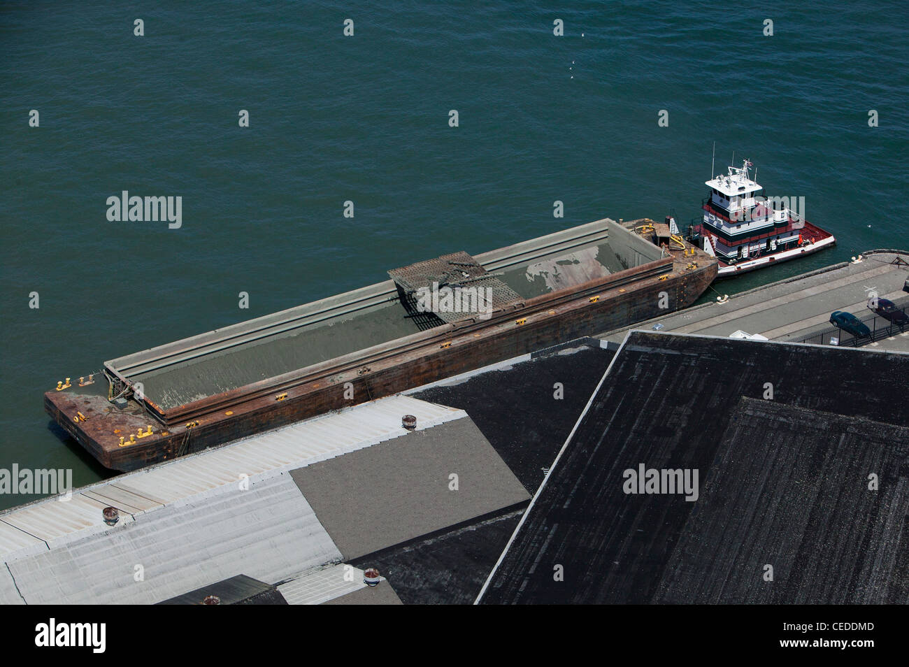 aerial photograph tug boat and barge at San Francisco pier - Stock Image