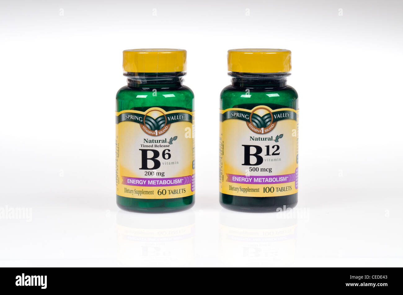 Bottles of Vitamins B6 and B12 on white background cutout - Stock Image