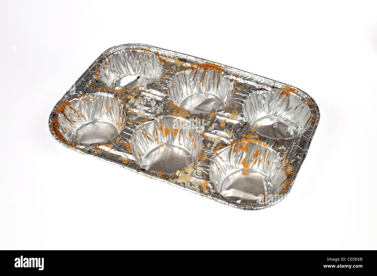 Empty muffin aluminum foil 6 pack tin on white background cutout - Stock Image