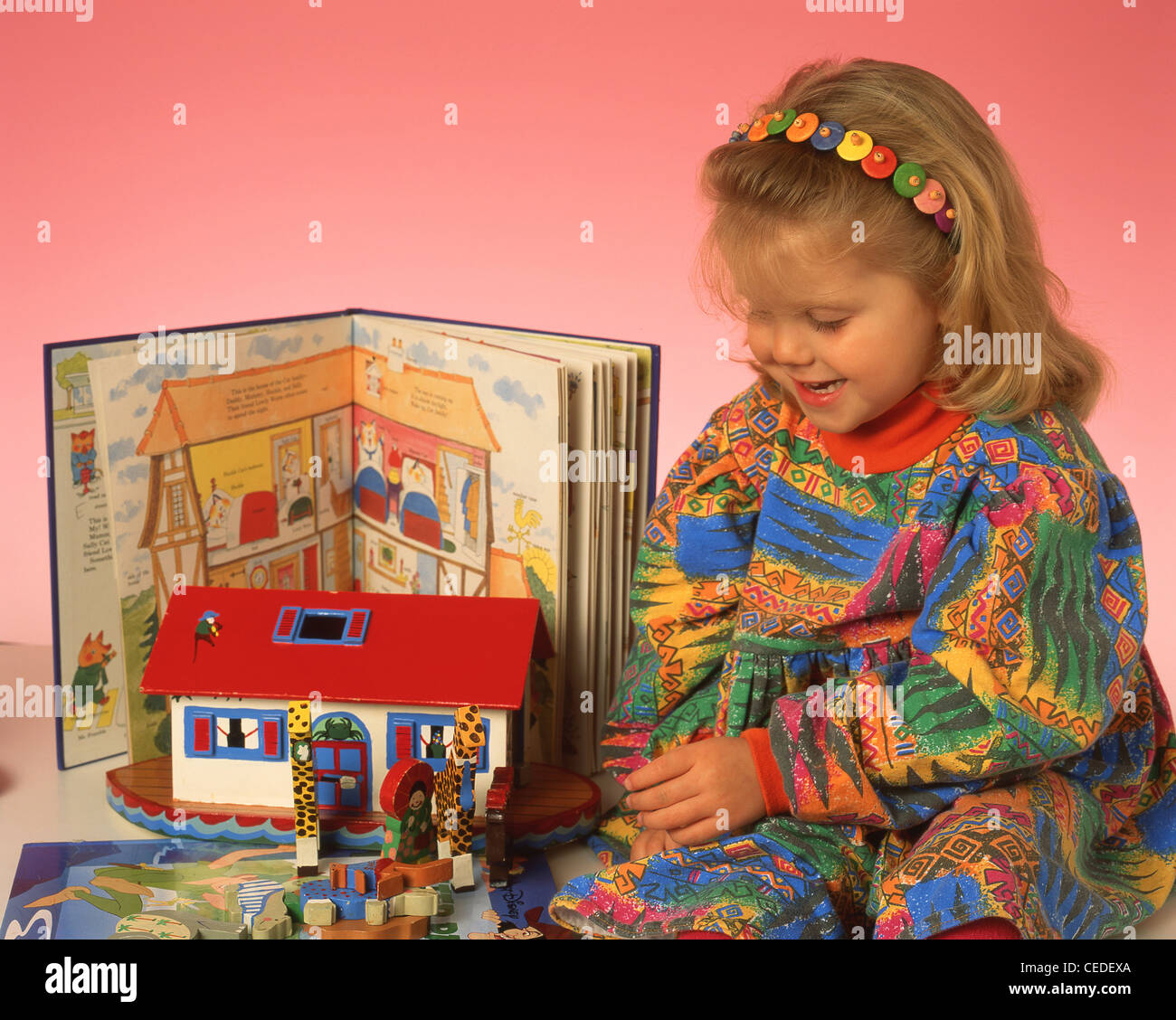 Young girl playing with toys, Berkshire, England, United Kingdom - Stock Image