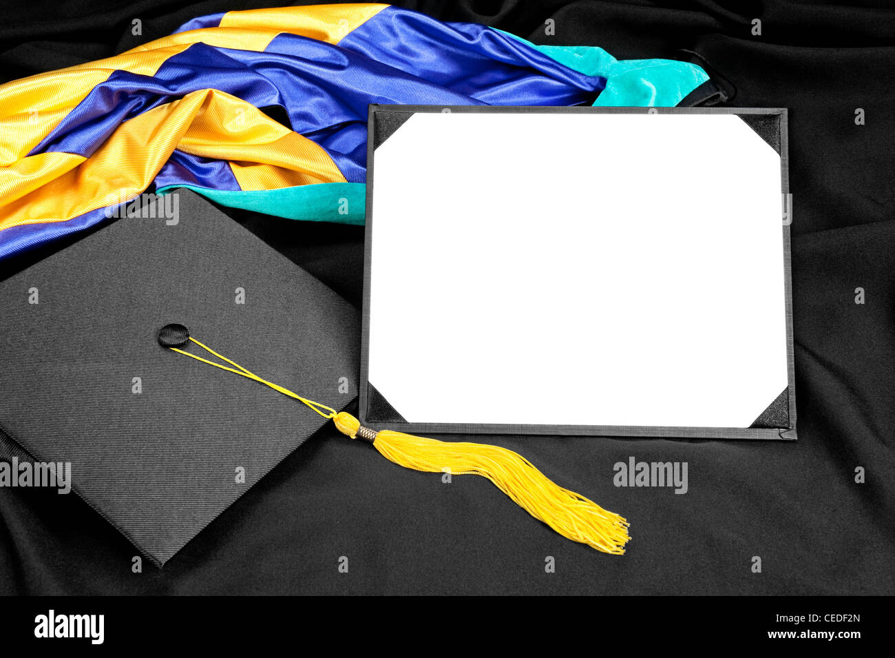 A graduation setting with cap,tassel, gown, hood and blank diploma for designers to place copy. - Stock Image