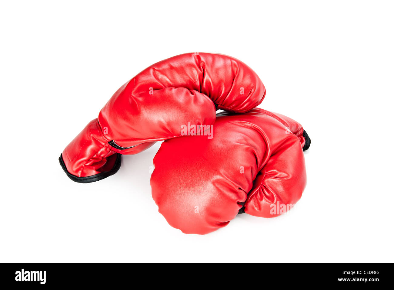 A pair of new boxing gloves on a white background - Stock Image