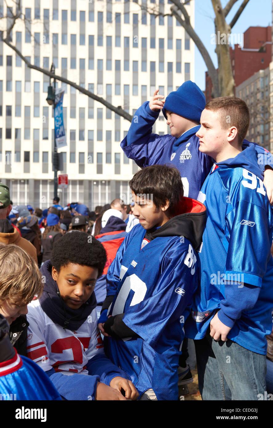 New York Giant fans, ticker tape, NY, USA - Stock Image