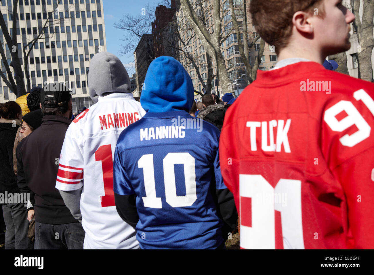 New York Giants fans in shirts, Ticker tape - Stock Image