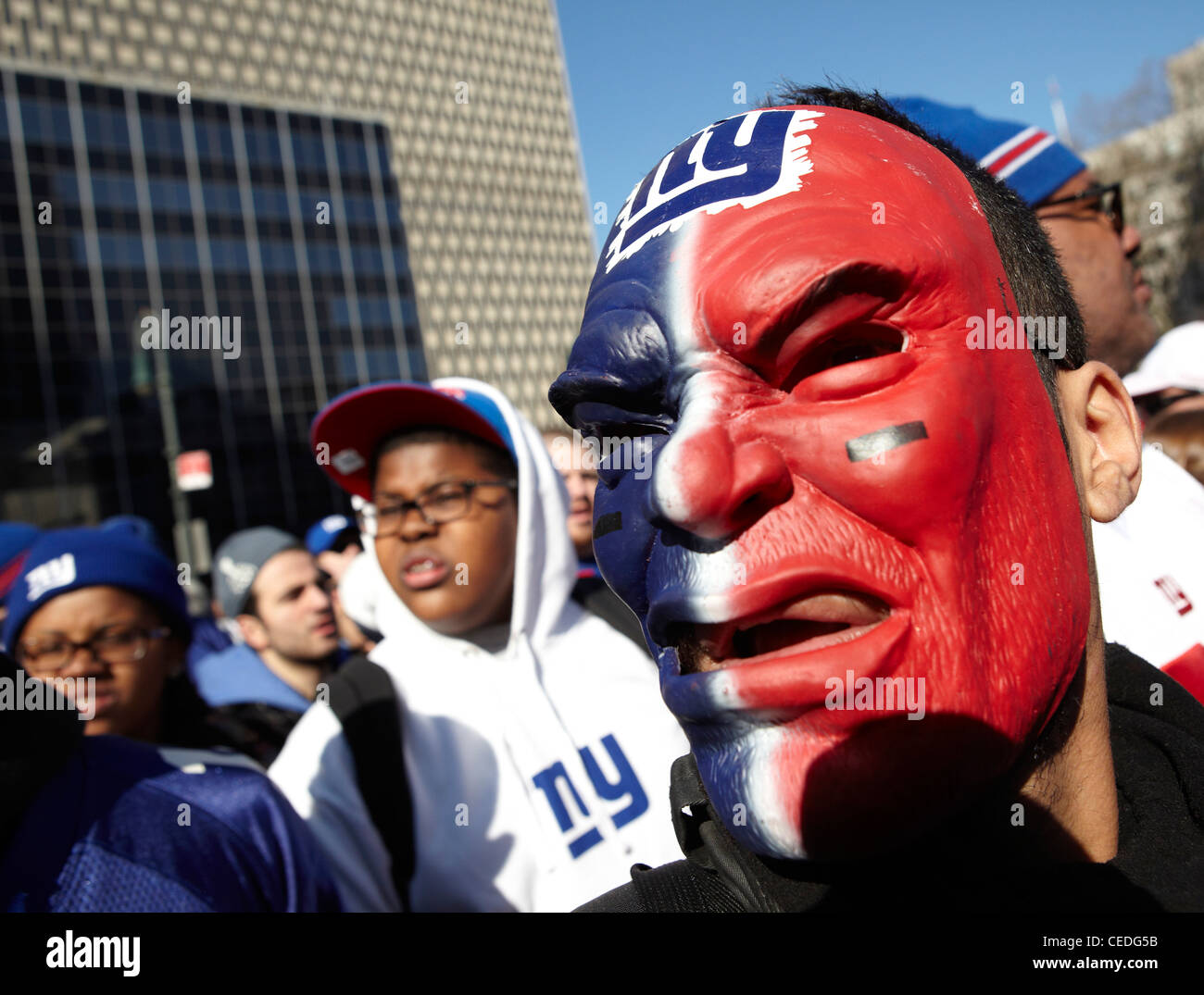 New York Giant fan in red mask, ticker tape, NY, USA - Stock Image