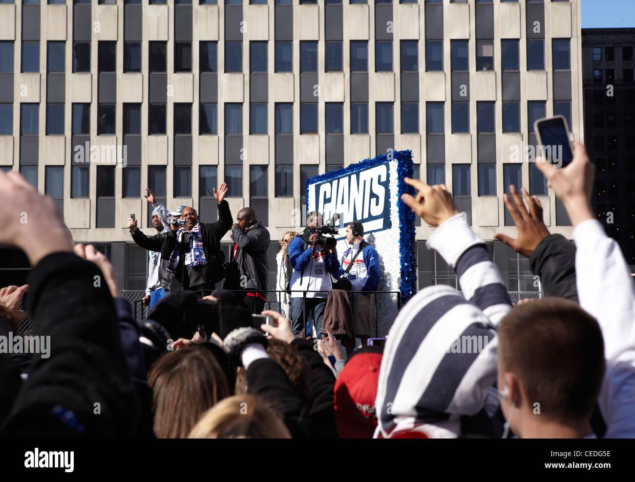 New York Giant fans parade, ticker tape, NY, USA - Stock Image