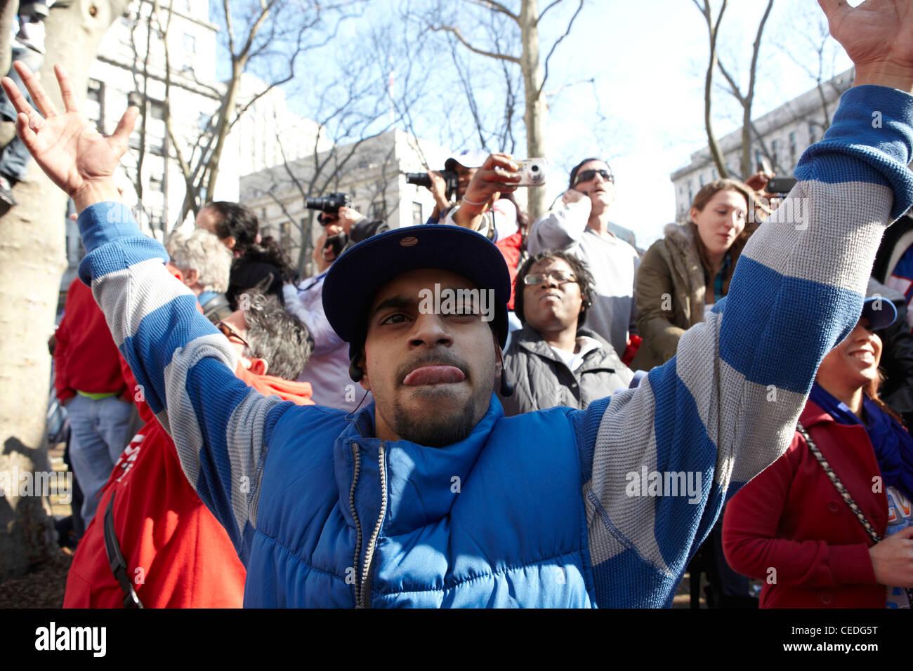 New York Giant fan, ticker tape, NY, USA - Stock Image