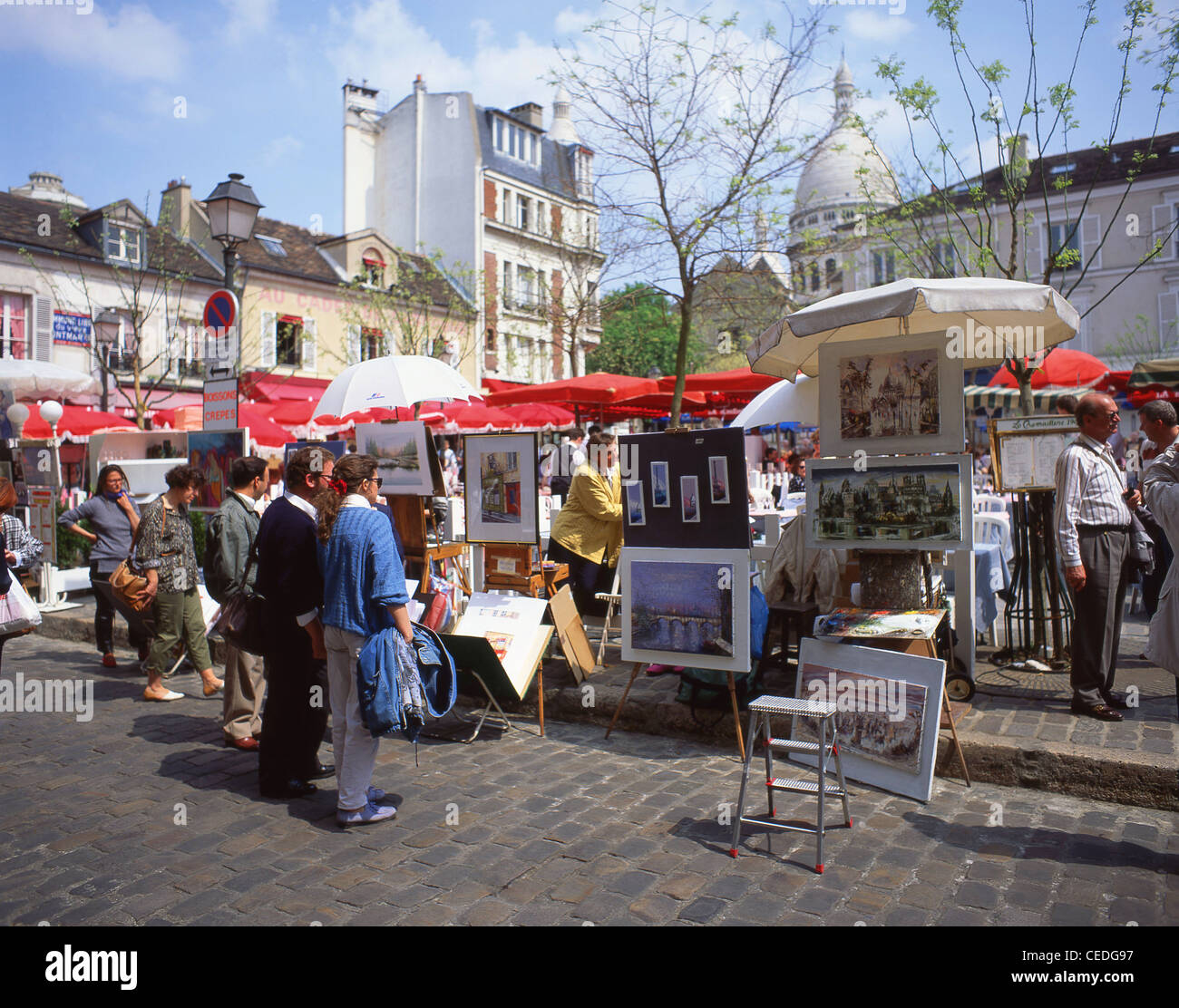 Artist stalls in Place du Tertre, Montmartre, Paris, Île-de-France, France - Stock Image
