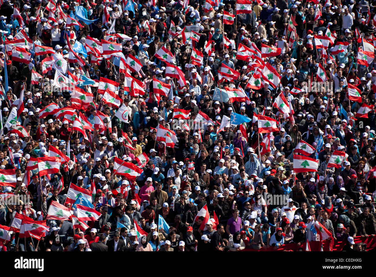 High shot of flag-waving demonstrators filling Martyrs Square at a political rally in Beirut, Lebanon. - Stock Image