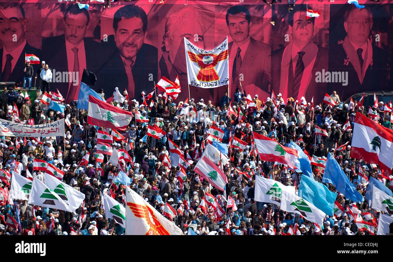 The faces of assassinated politicians form the backdrop of a political rally held in Martyrs Square, Beirut, Lebanon - Stock Image