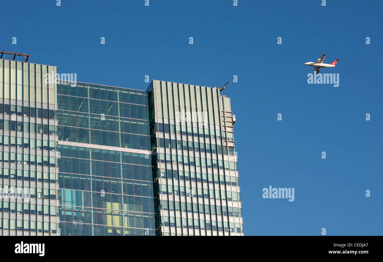 British Aerospace Avro Airliner and Barclays Bank HQ at One Churchill Place, Canary Wharf, Docklands, London, United - Stock Image