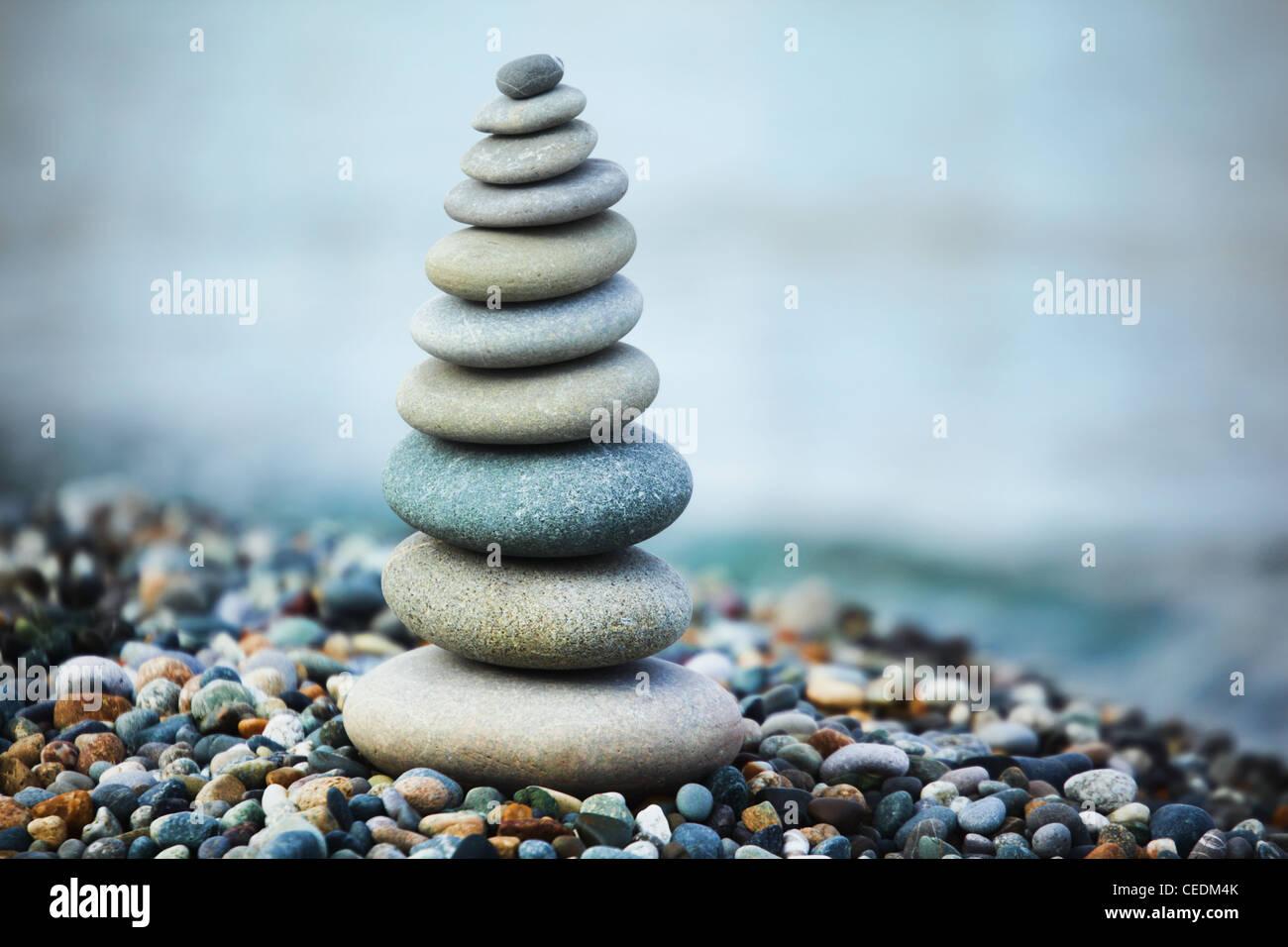 zen stones on beach - Stock Image