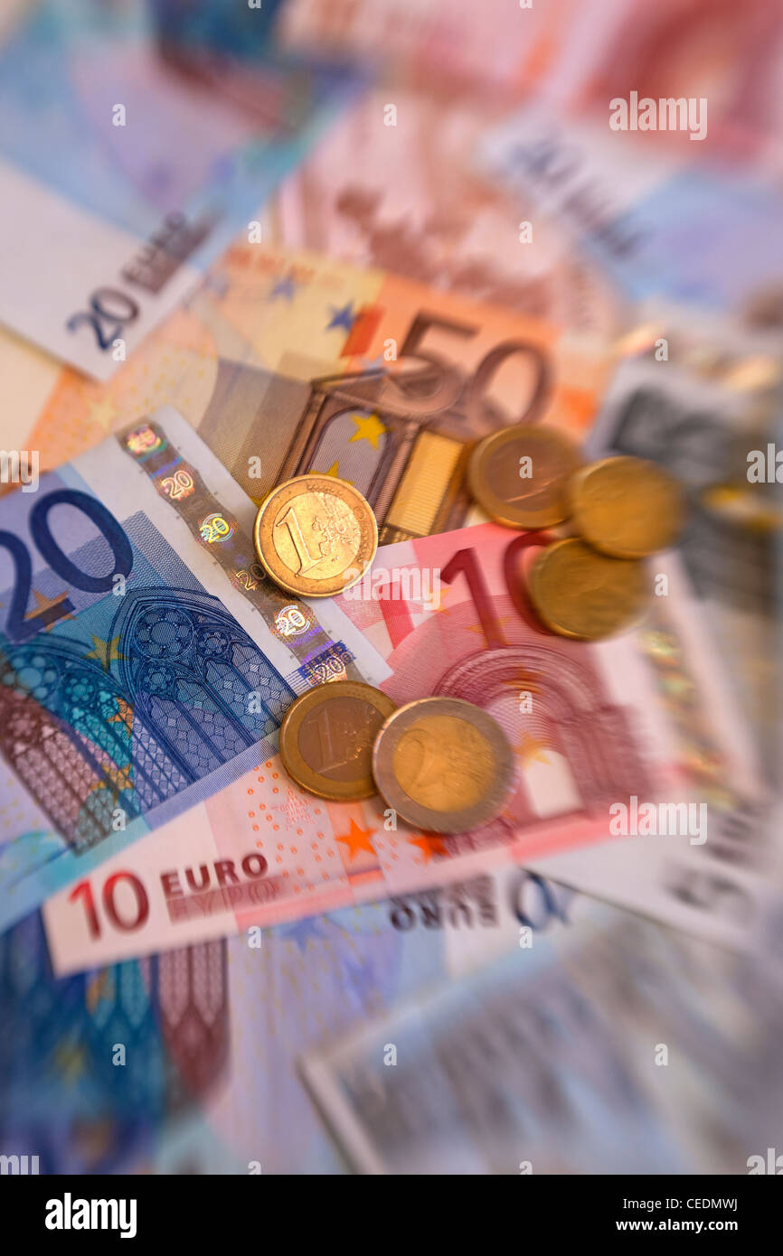 A pile of Euro currency money notes and coins - Stock Image