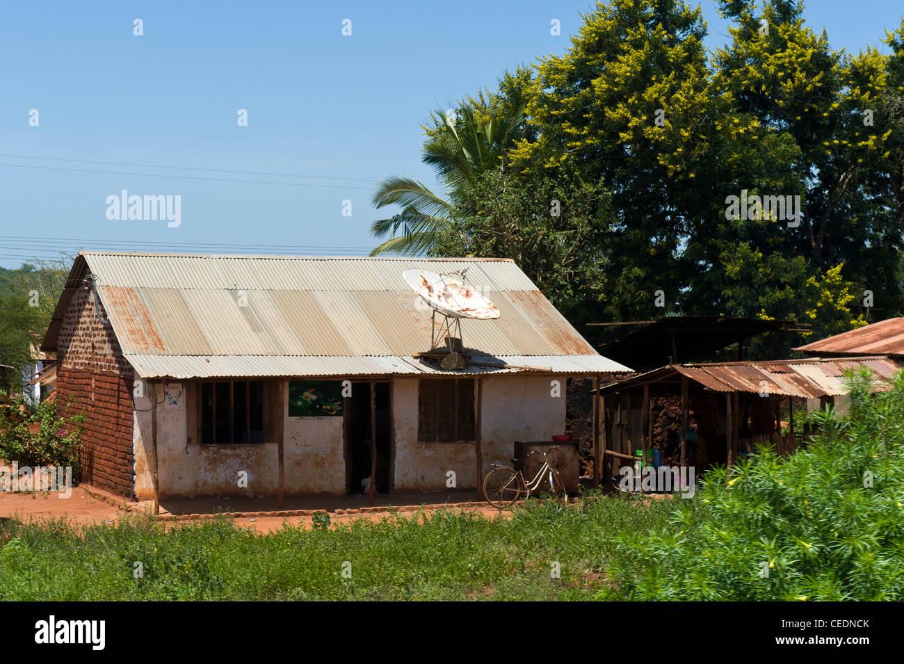 House with satellite dish Pwani Region Tanzania - Stock Image