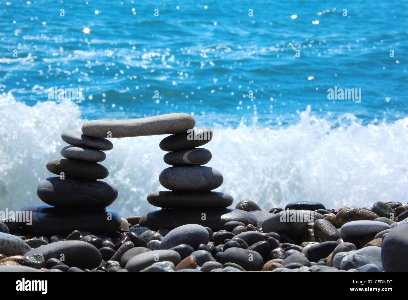 arch from pebble on seacoast - Stock Image