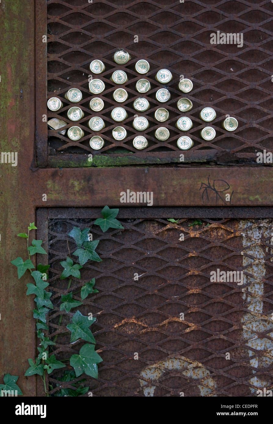 Rusty gate with bottle tops & ivy, Gilford, County Down. - Stock Image