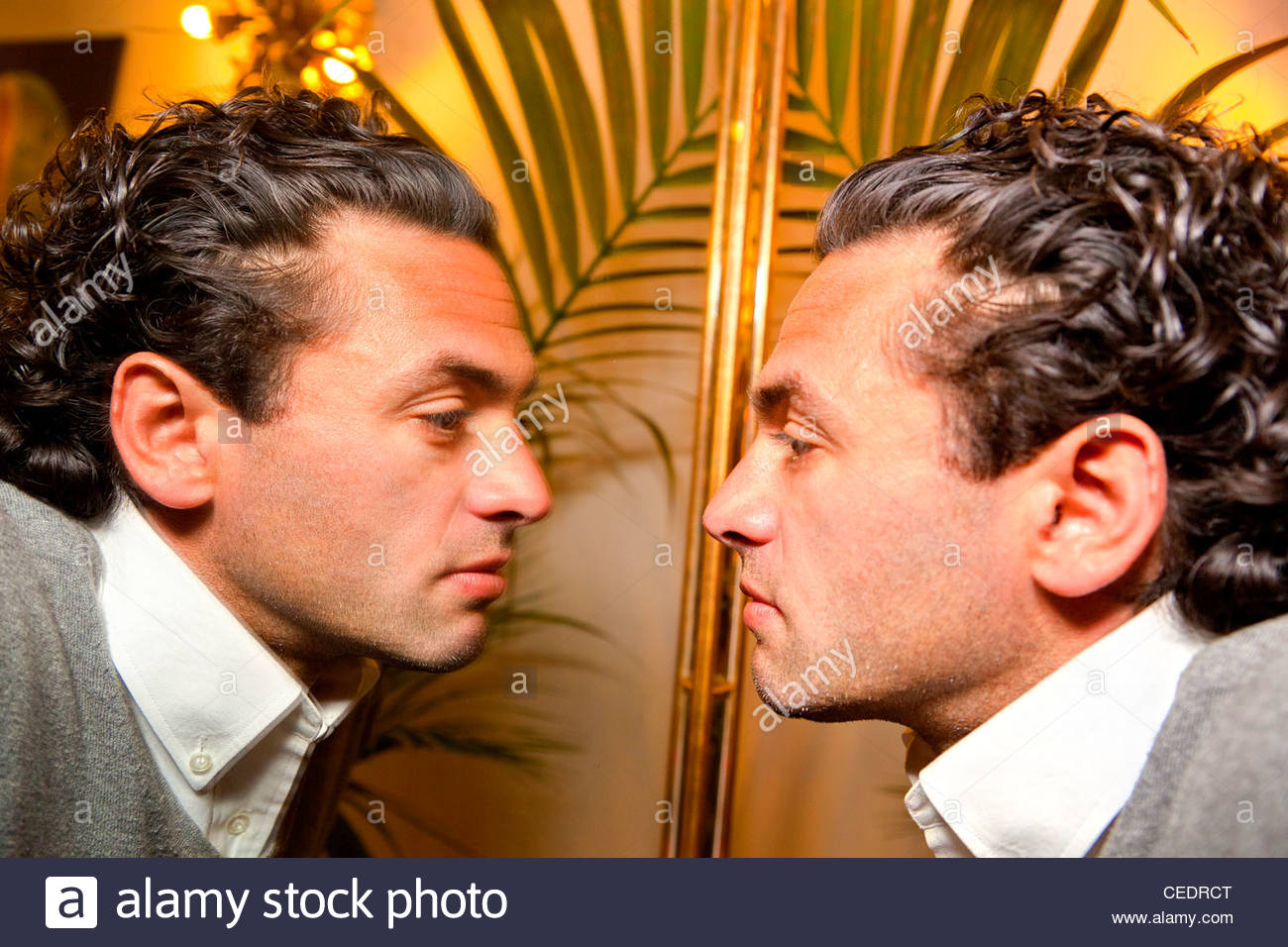 Man looking in the mirror Stock Photo