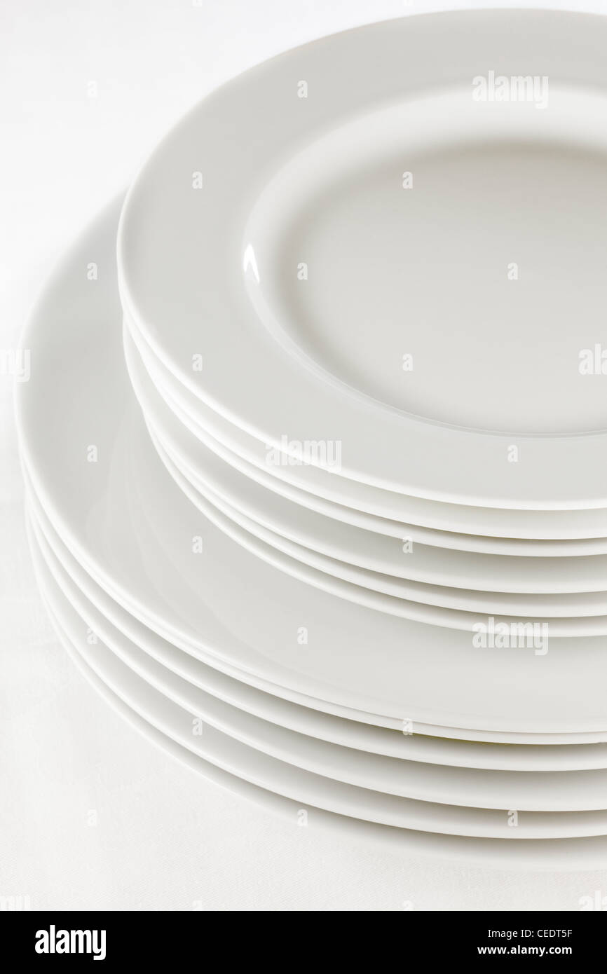 stack of white plates - Stock Image