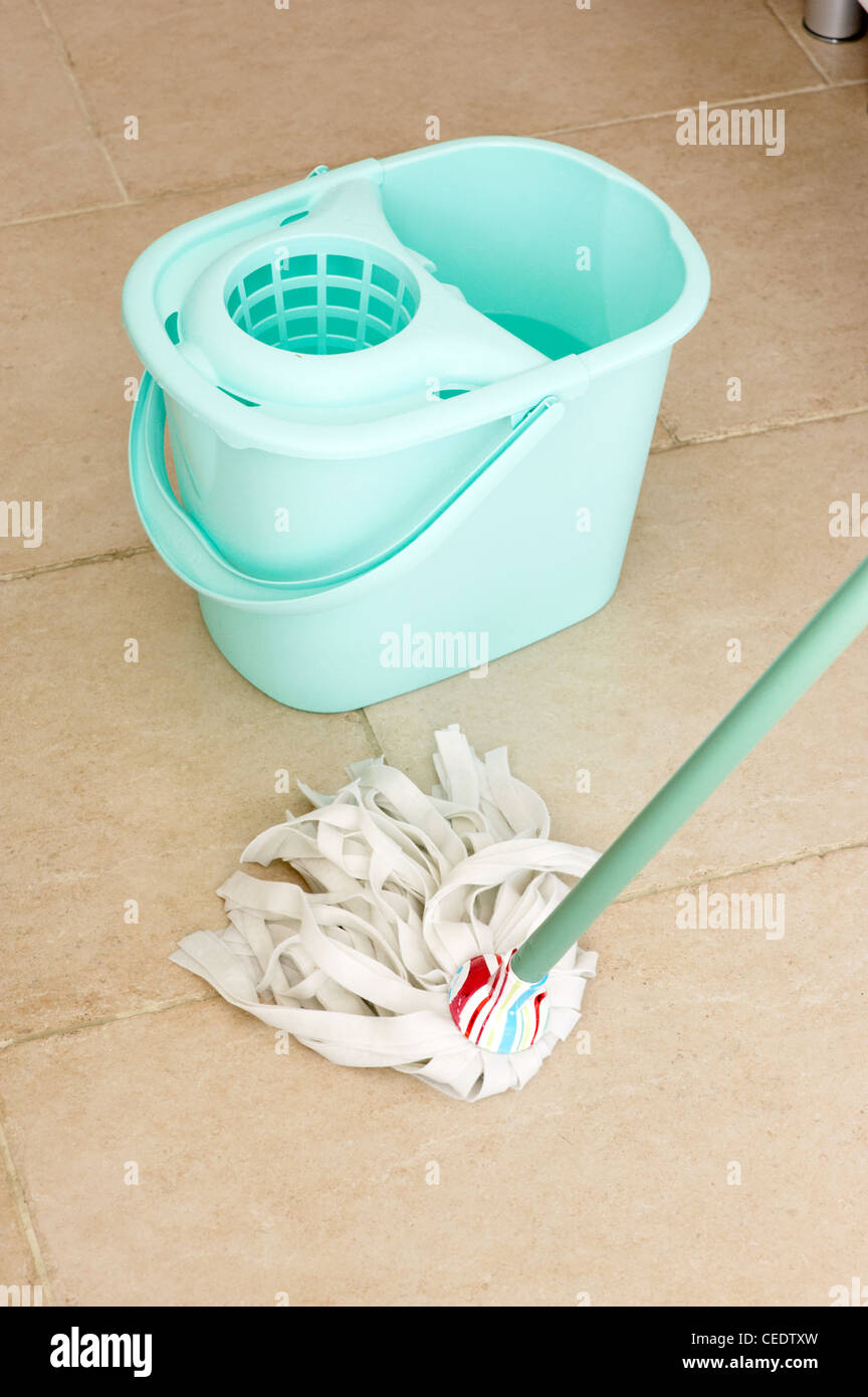 Wiping floor with mop - Stock Image