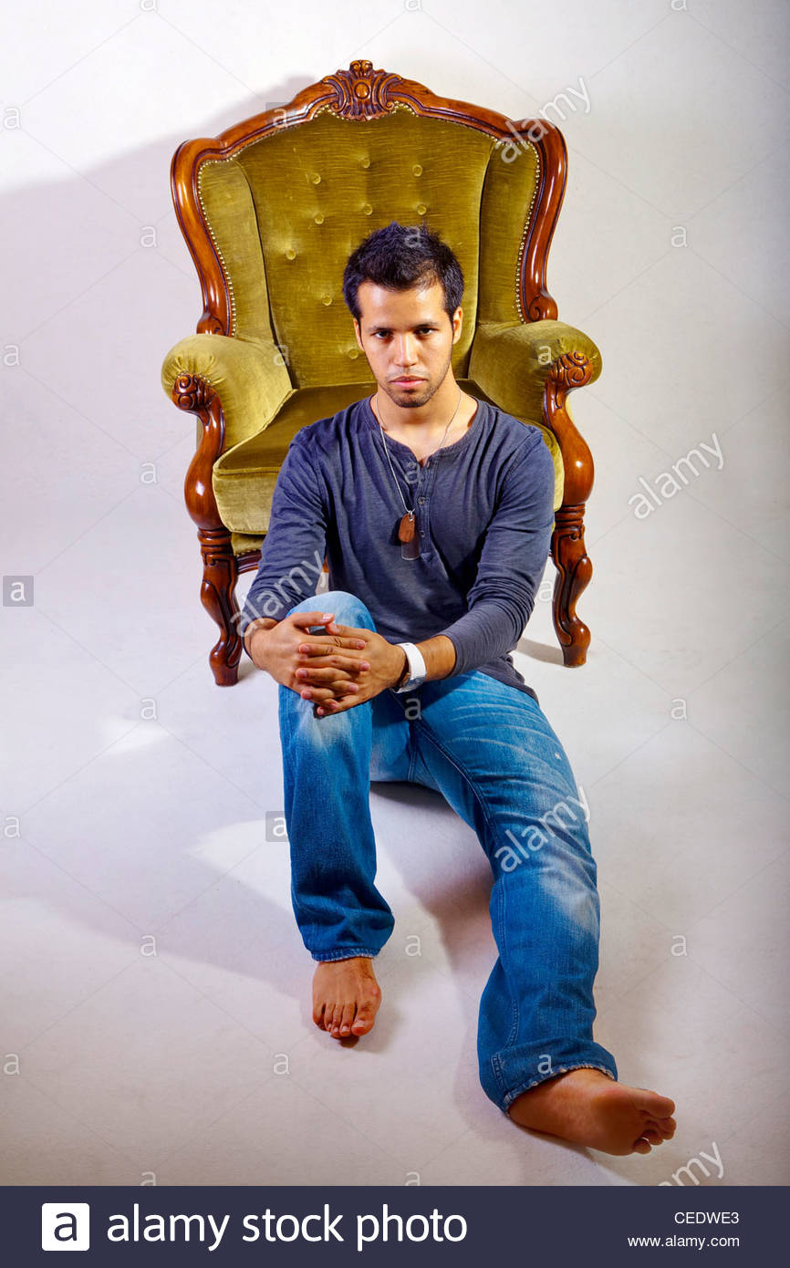 Male portrait sitting on the floor - Stock Image