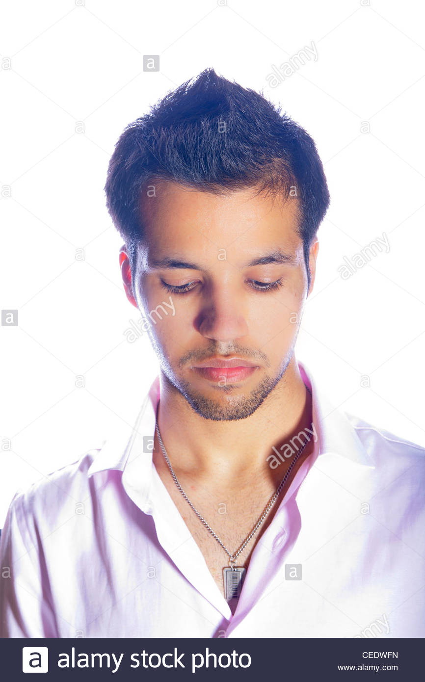 Male studio portrait looking down - Stock Image