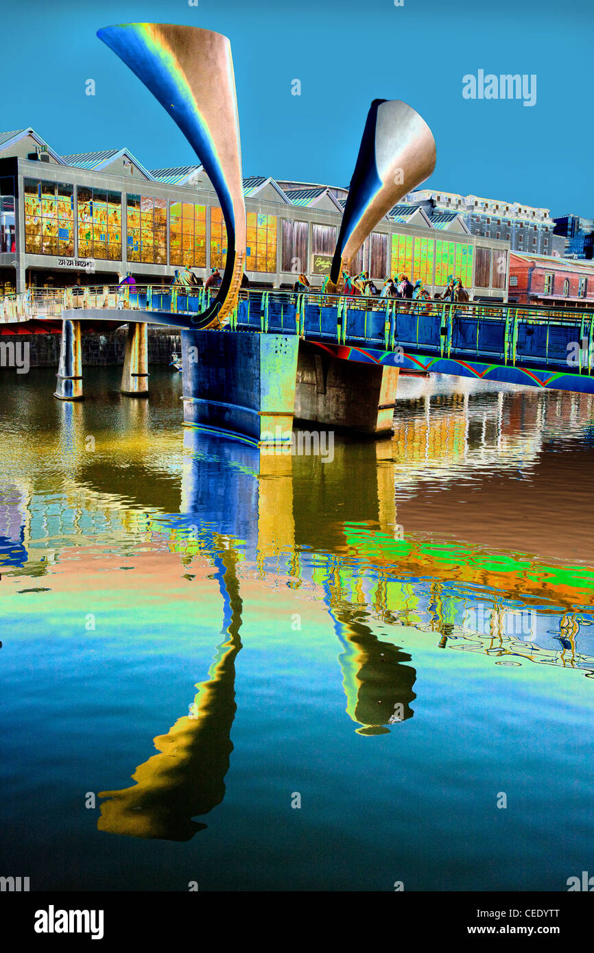 Solarised image of Bristol's Pero's Bridge across the floating harbour with its horn shaped counterweights - Stock Image