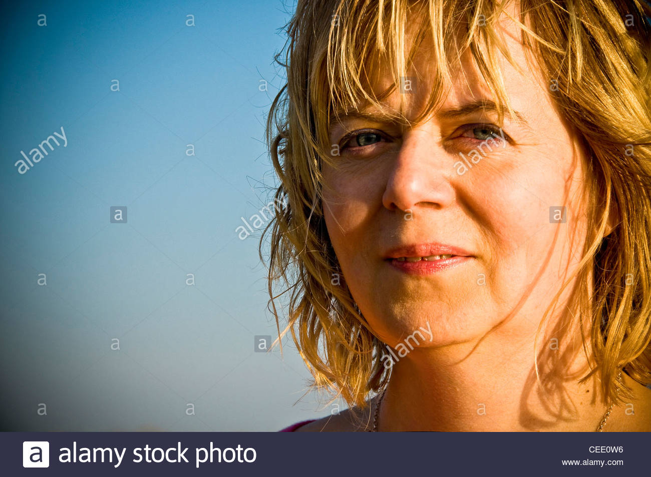 optimistic blond woman in her forties - Stock Image