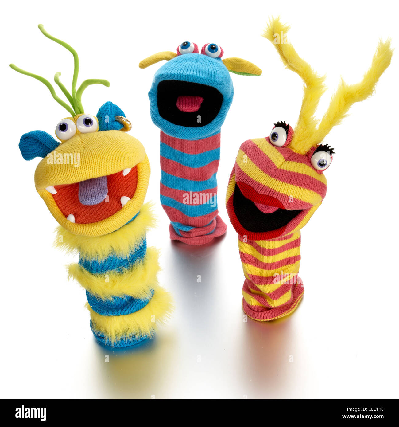 3 colorful fun hand puppets - Stock Image