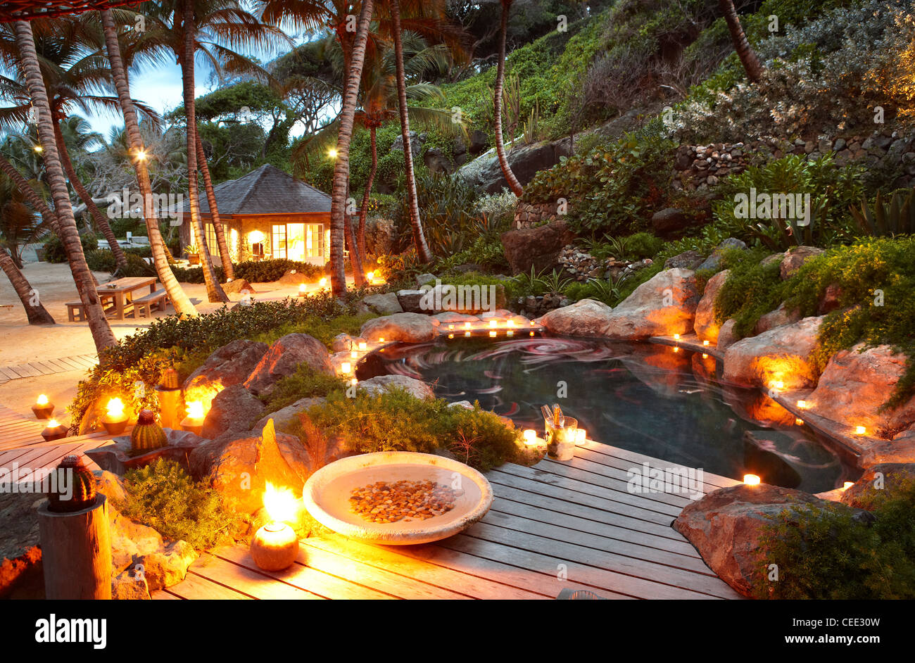 candle lit beach plunge pool - Stock Image