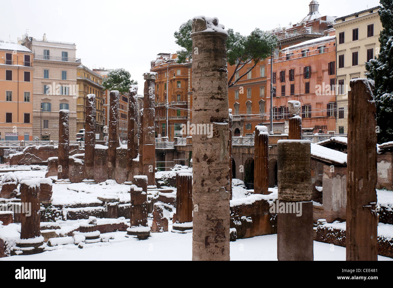 The snow covered archaeological area of Largo di Torre Argentina, Rome Italy - Stock Image
