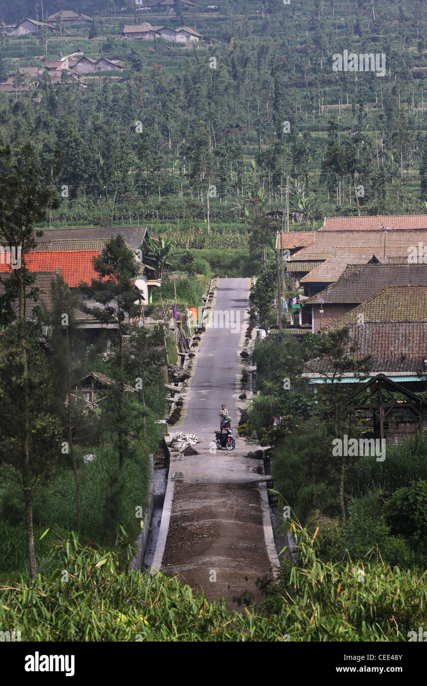 Village road on Mount Merapi Yogyakarta Indonesia Central Java Southeast Asia agriculture Javanese Culture town - Stock Image