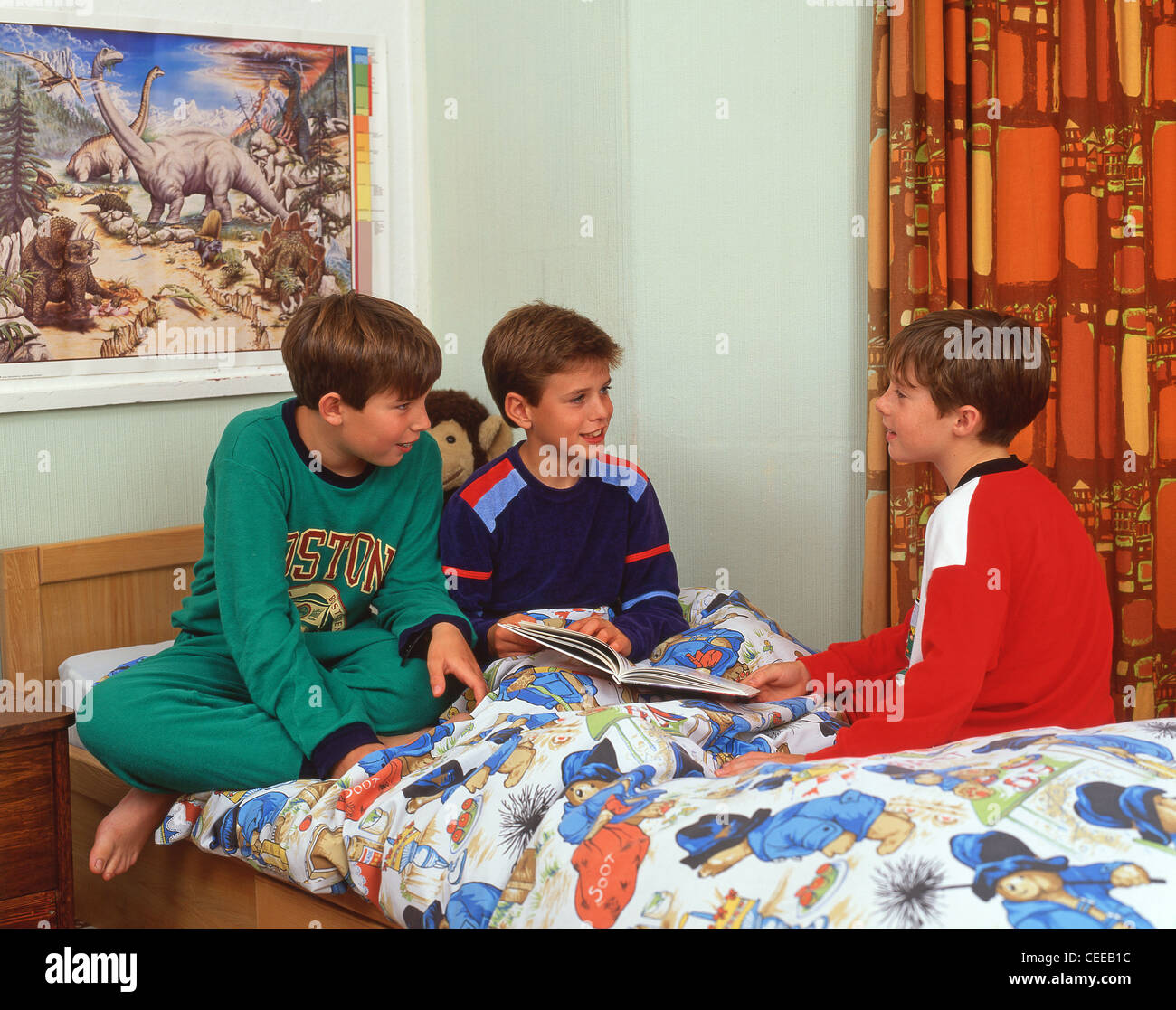 Young boys in dormitory at private school in Surrey, England, United Kingdom - Stock Image