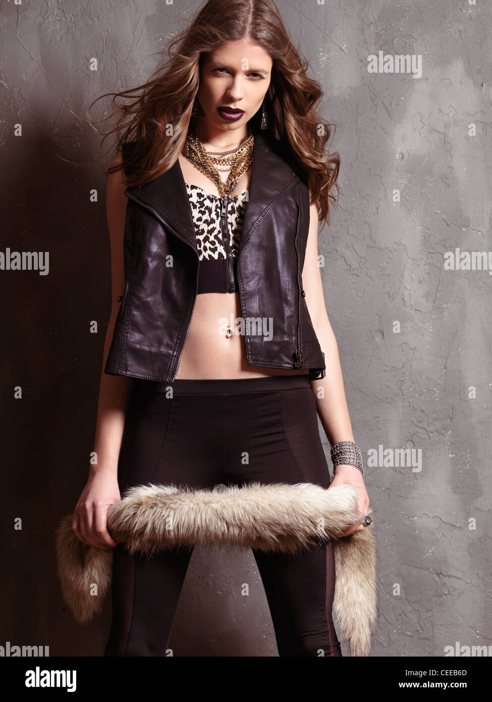 Fashion photo of a young woman wearing grunge fashion style clothing of 90s - Stock Image