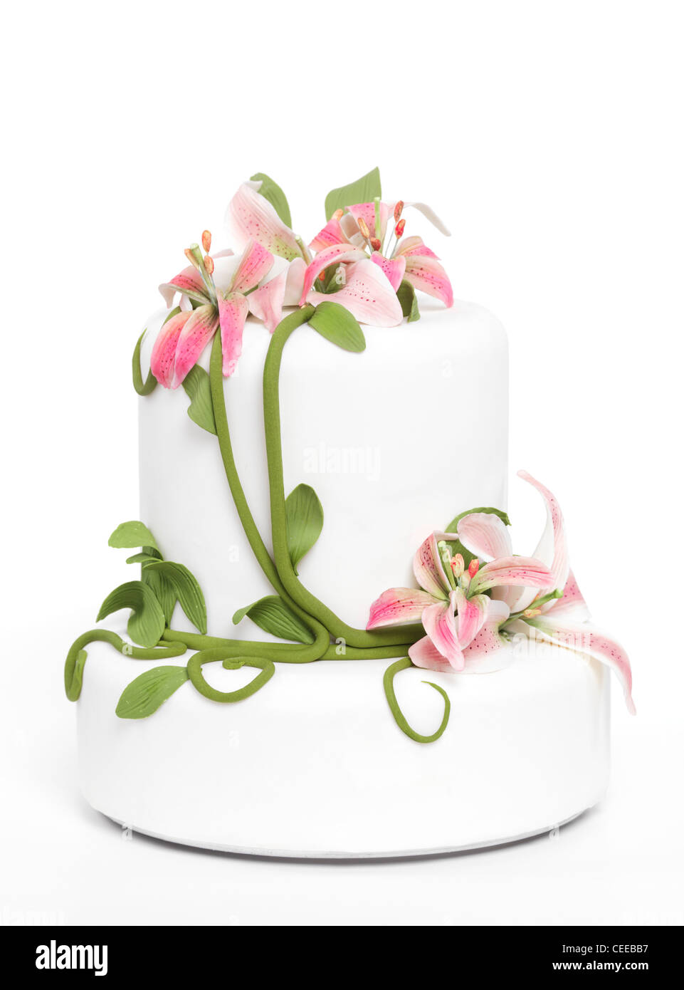 Fancy cake with lilies isolated on white background - Stock Image