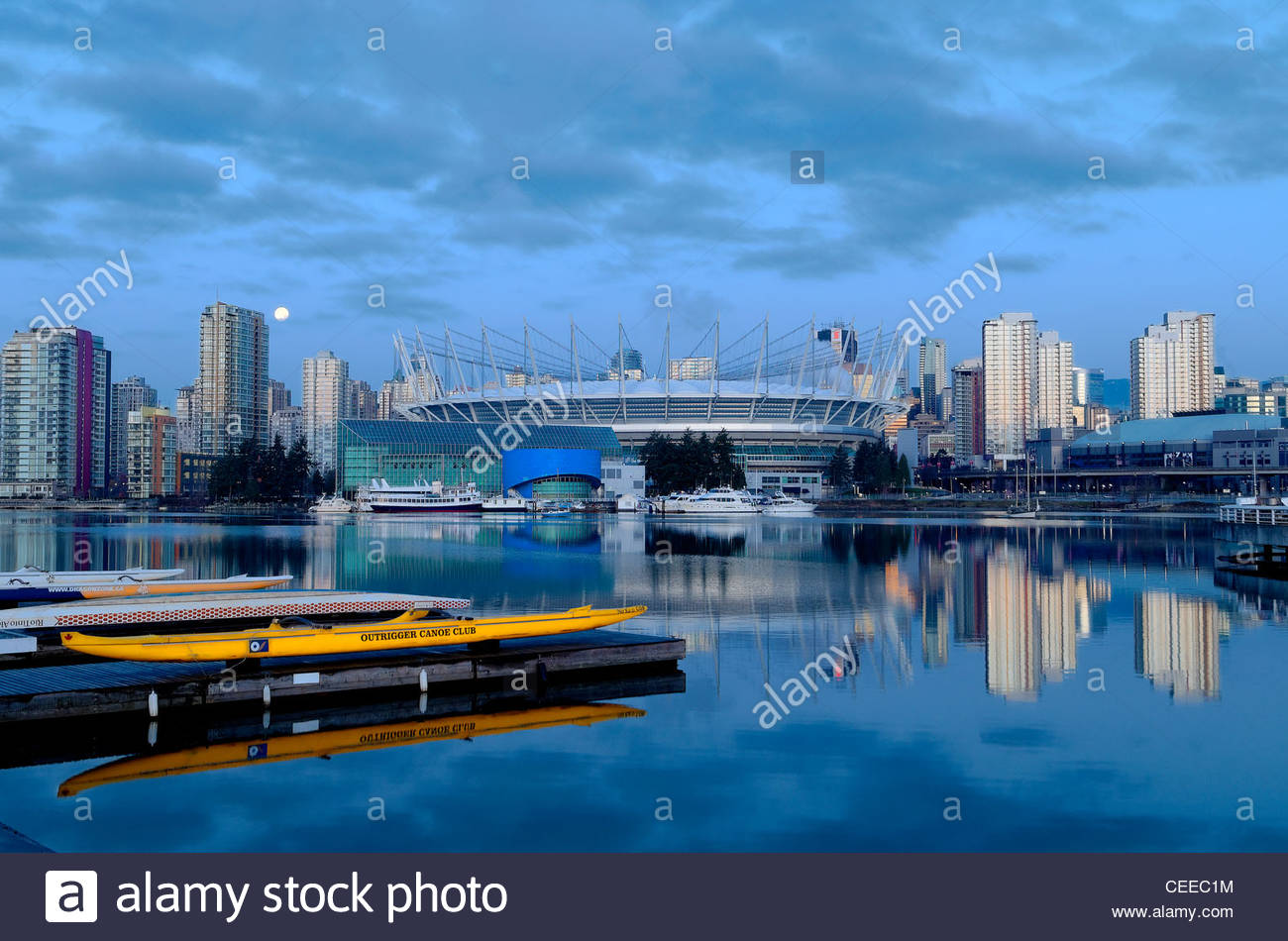 BC Place Stadium, False Creek,  Vancouver, BC, Canada, at dawn with yellow canoe. - Stock Image