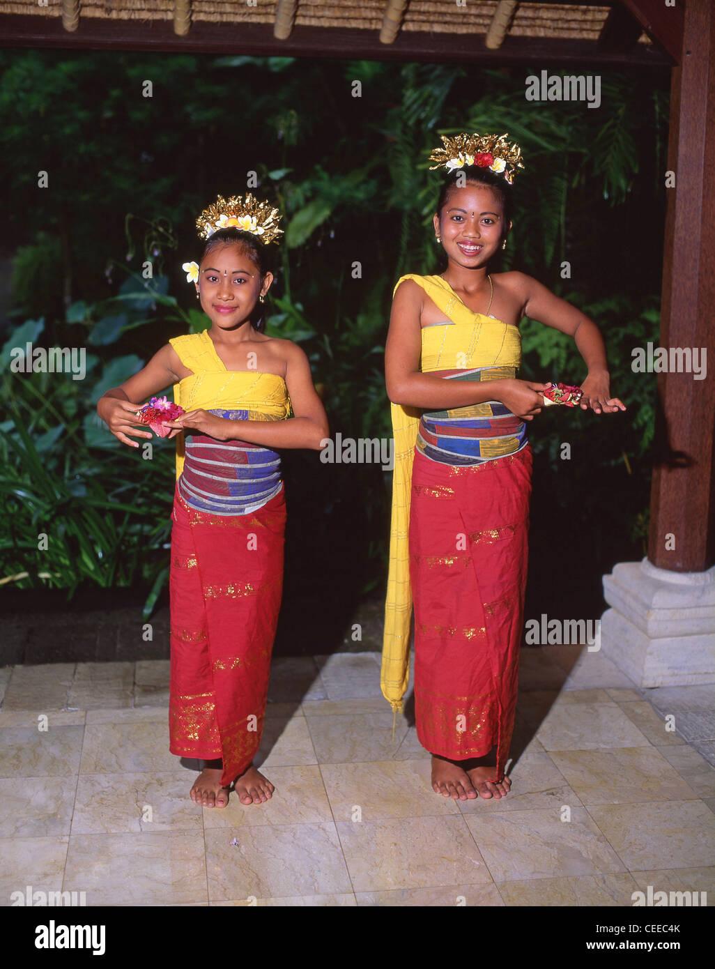 Young female Balinese dancers, Bali, Bali Province, Lesser Sunda Islands, Indonesia - Stock Image
