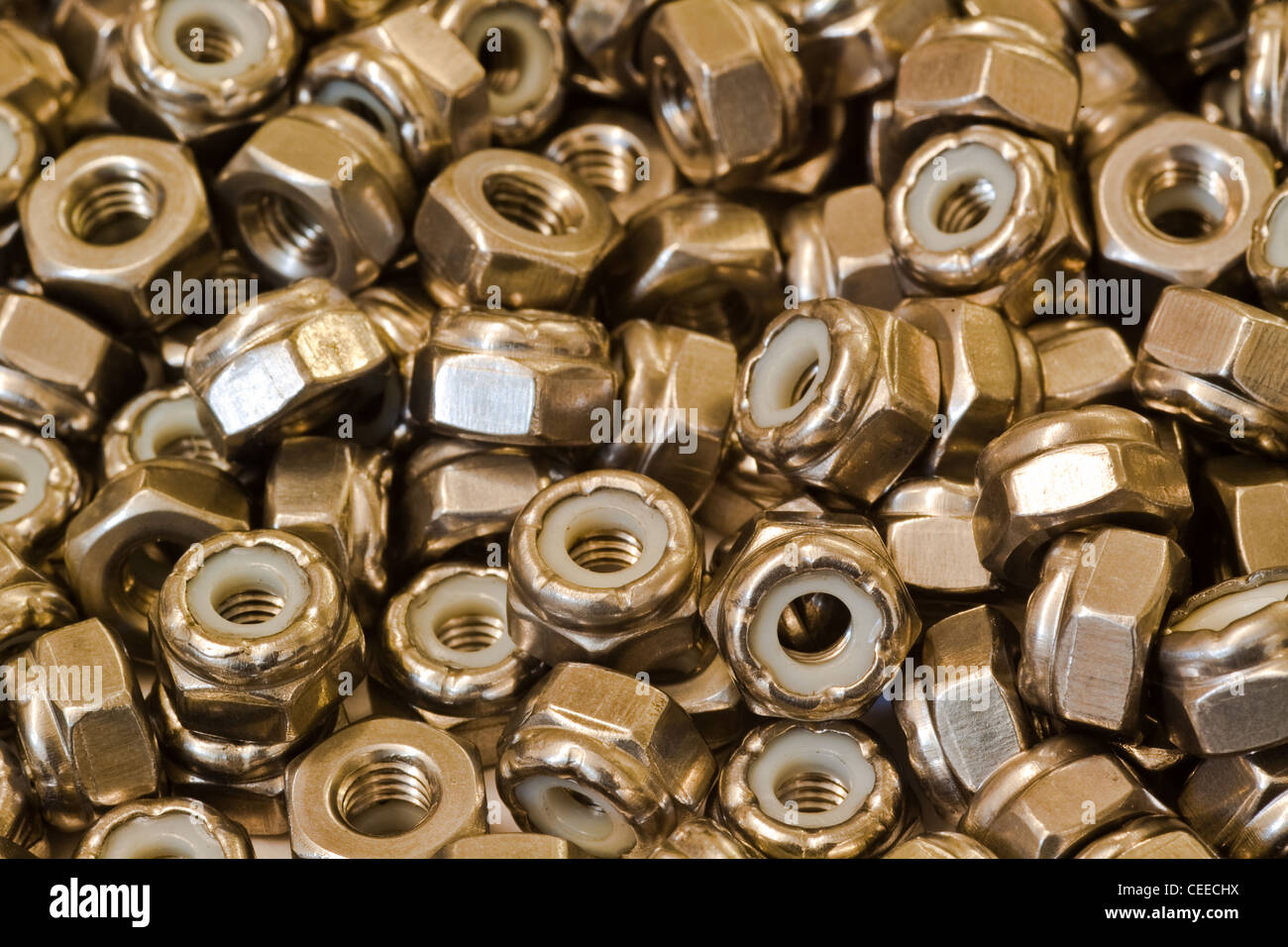 An abstract image of steel self-locking nuts - Stock Image