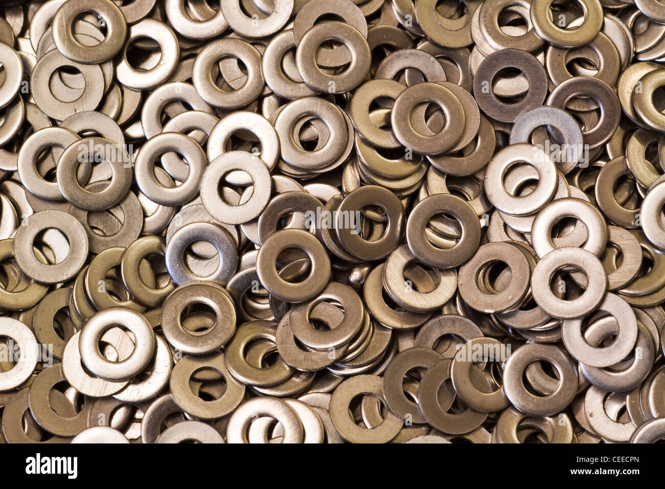 An abstract array of flat steel plain washers - Stock Image