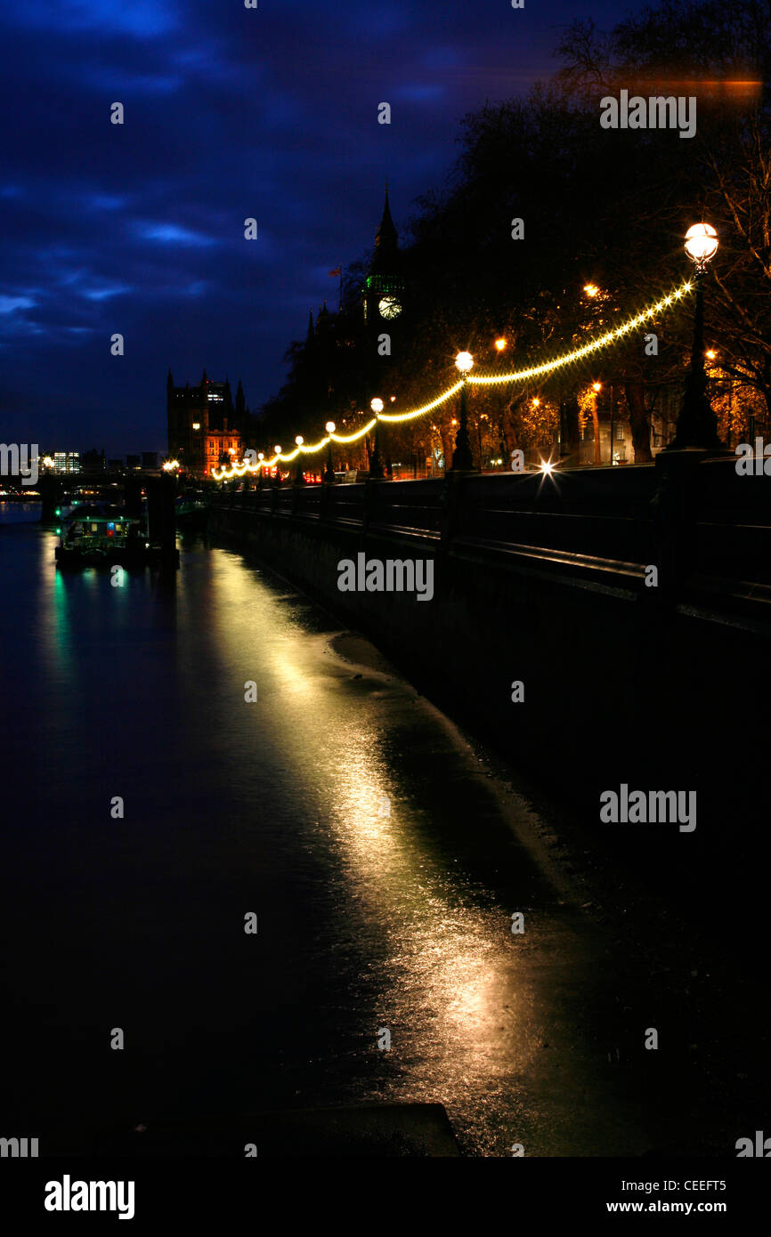 View along the River Thames at Victoria Embankment to Houses of Parliament, Westminster, London, UK - Stock Image