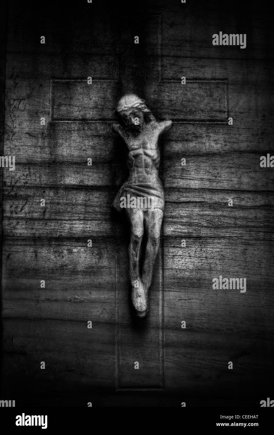 Broken crucifix on wall - Stock Image
