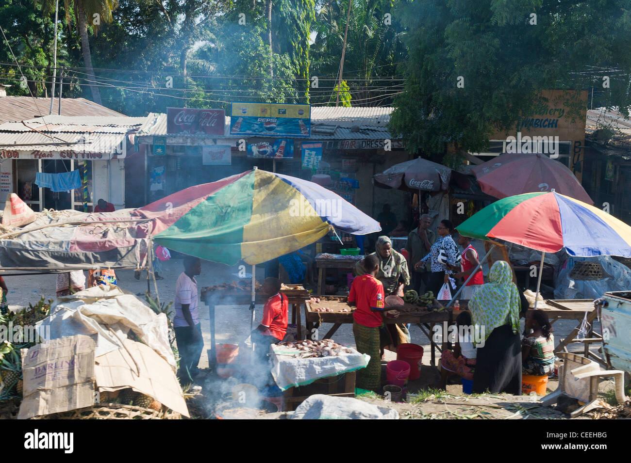 Market stands along a road in Dar es Salaam Tanzania - Stock Image