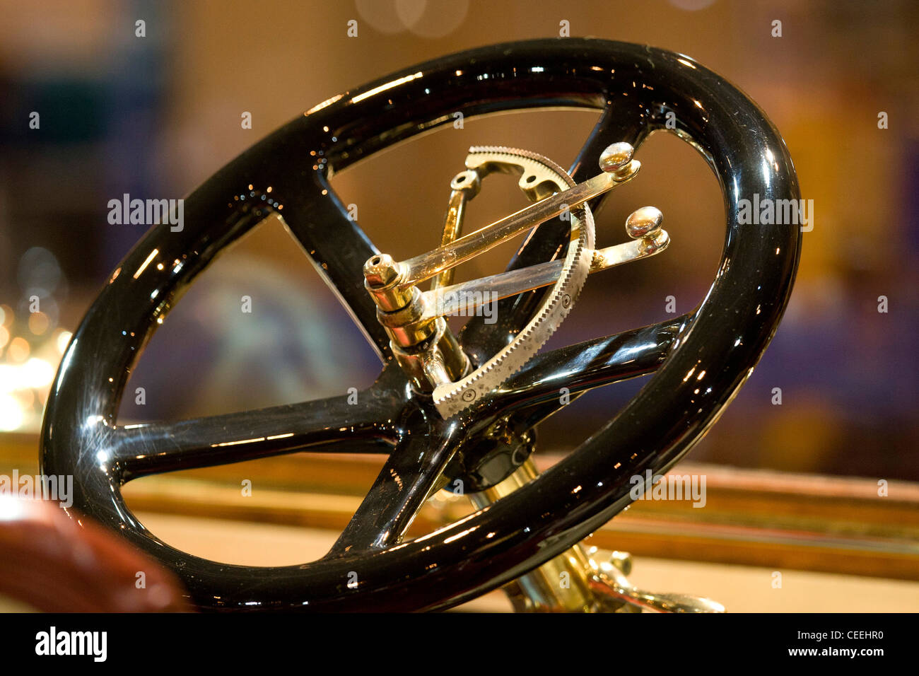 Classic car steering wheel pictured at the Classic Car Show held at the NEC, Birmingham. - Stock Image