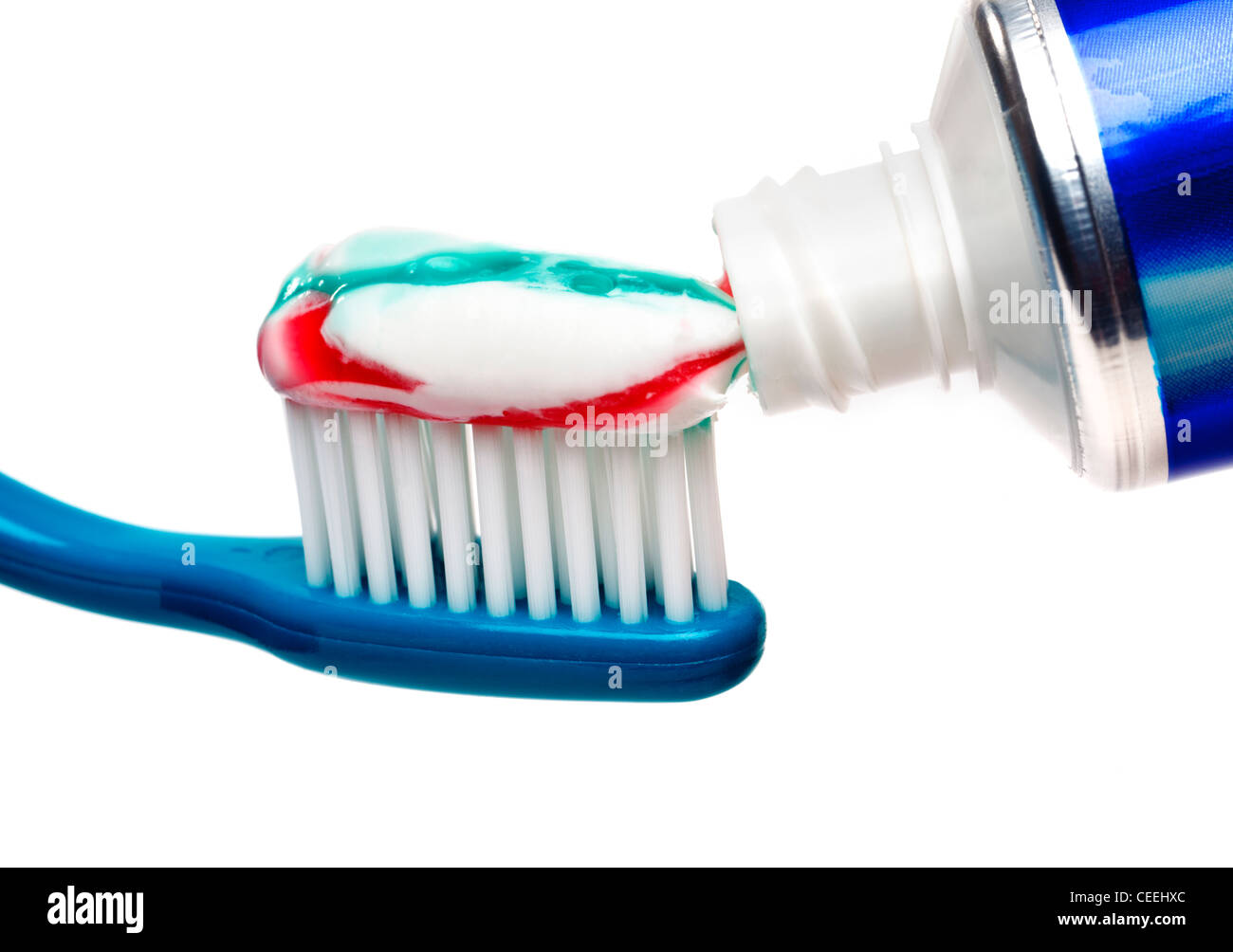 Tooth brush and toothpaste tube - Stock Image