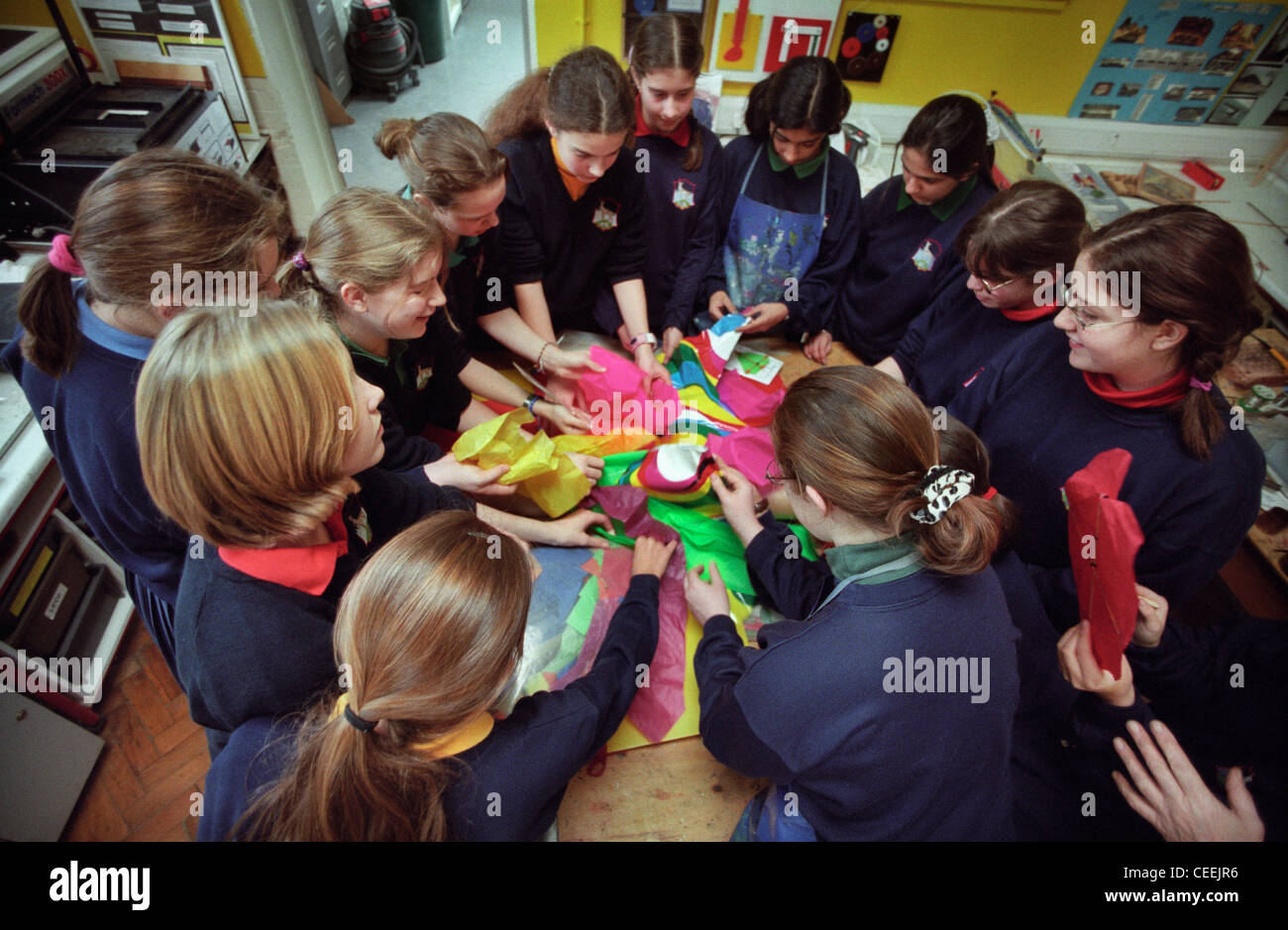 Schoolgirls make Kites with coloured tissue paper in a Arts and Crafts classroom at Roedean school. - Stock Image