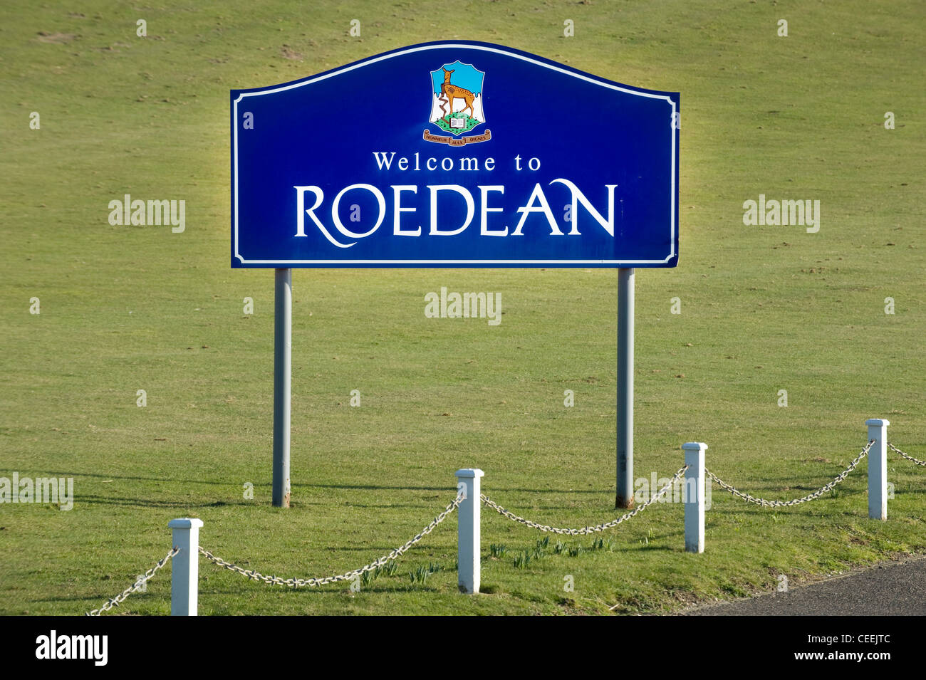 The School sign with crest badge at the entrance to Roedean School for Girls, the private fee paying school near - Stock Image